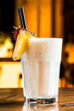 Pina colada cocktail in a night pub.