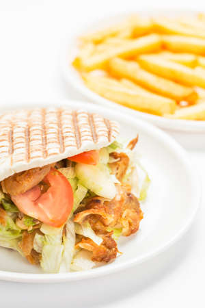 Doner kebab with fries isolated on white background. photo