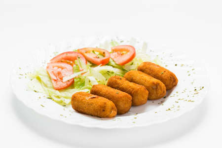 Typical spanish pub food, croquettes with salad.