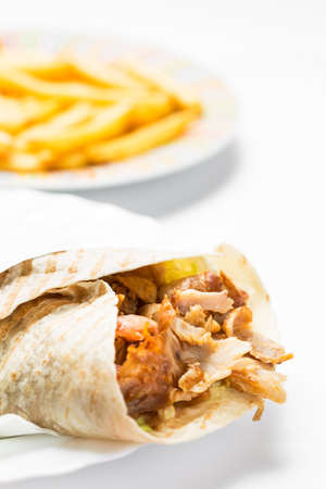 Doner kebab with fries isolated on white background. Stock Photo