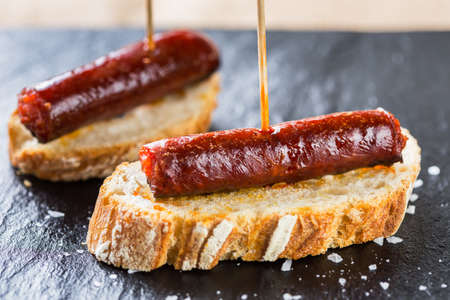Typical spanish tapas: Delicious pork sausage called chistorra.