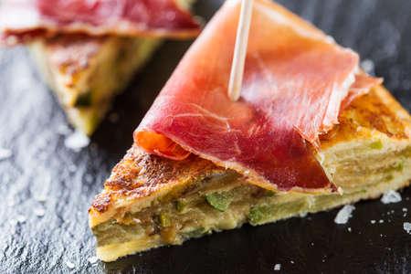 serrano: Typical spanish tapas: Tortilla de patatas with serrano ham.