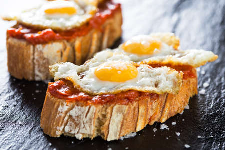 Typical spanish food tapas: Quail eggs and sobrada of Mallorca