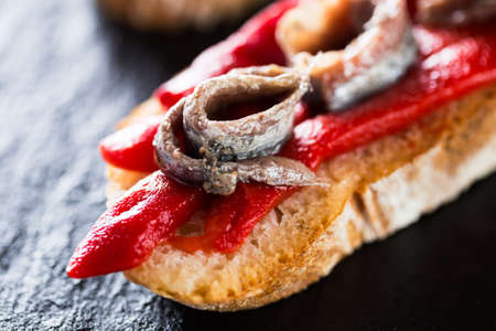 spanish food: Typical spanish pincho: Anchovies with pepper. Stock Photo