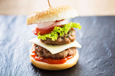 sliders: Delicious homemade double mini burger, beef meat.