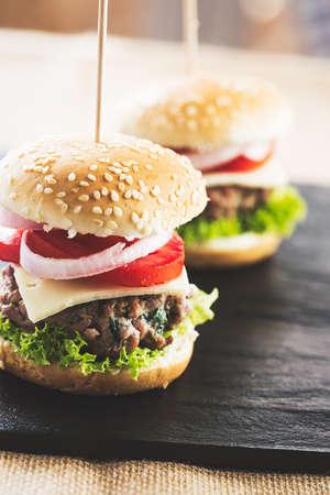 sliders: Mini burgers appetizer, beef meat. Stock Photo