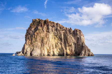 Aeolian islands view from the sea in a cloudy day. Stock Photo