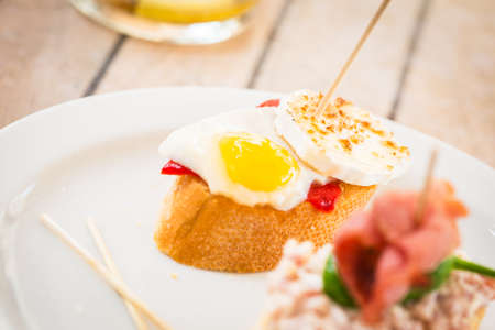 toothpick: Spanish tapas on white plate. Stock Photo