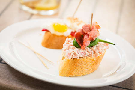 spanish tapas: Spanish tapas on white plate. Stock Photo