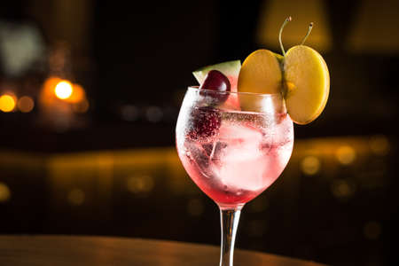 gin: Gin Tonic with mix of fruits, cocktail night club. Stock Photo
