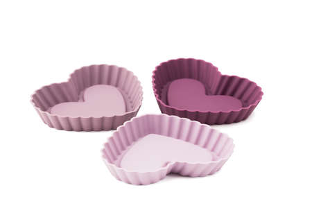 solated on white: New silicon cupcake tin heart shape solated white background.