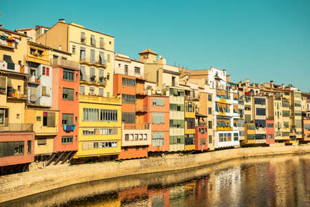 historical reflections: Urban landscape of Girona, the most picturesque destination of Costa Brava vintage colors edition Stock Photo