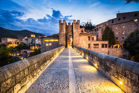jewish houses: Night landscape from the Besalu medieval village entry, Costa Brava. Spain.