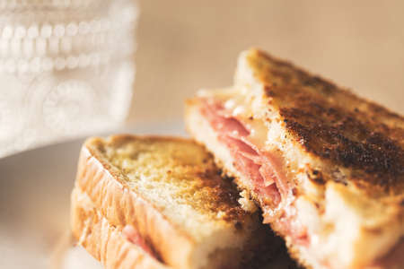 Typical toasted sandwich with cheese and pork ham. Vintage edition, detail.