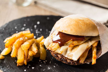 Street burger stuffed with cheese, potatoes and ketcgup sauce. Stock Photo - 45595981