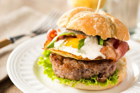 Great beef burger with fried egg, bacon, arugula and caesar sauce.