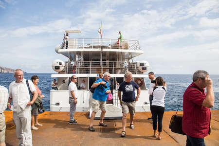 aeolian: SICILY - OCTOBER 05: Tourists visit volcanic Stromboli island in Sicily, famous by its Sciaria del Fuoco. October 05, 2015 Sicily, Italy. Editorial