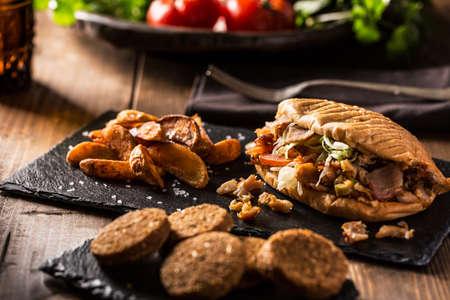Doner kebab and falafel on served wooden table