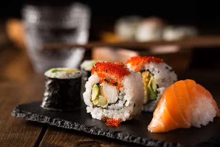 Fresh and delicious maki and nigiri sushi and sake glass. Stock Photo
