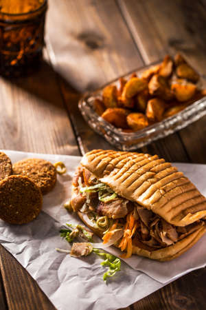 donner: Tasty chicken doner kebab with falafel on a wooden table Stock Photo