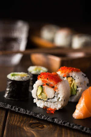 sake maki: Fresh and delicious maki and nigiri sushi and sake glass. Stock Photo