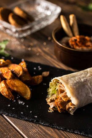 Tasty shawarma, potatoes, hummus and falafel. Typical turkish food. Stock Photo