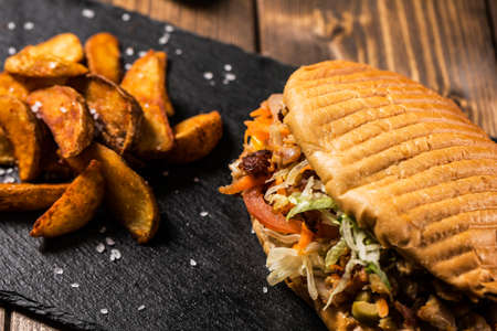 donner: Close up of chicken doner kebab with fried potato