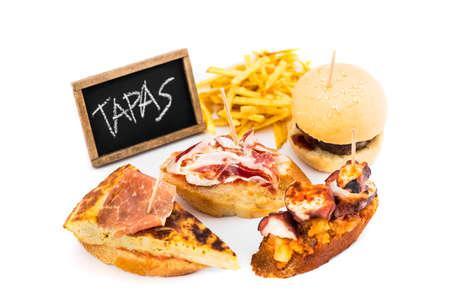 tapas espa�olas: Typical spanish tapas with chalkboard isolated on white background.