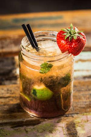 Fresh strawberry mohito on a pub. Stock Photo
