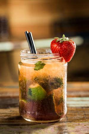 copy sapce: Fresh strawberry mohito on a pub. Stock Photo
