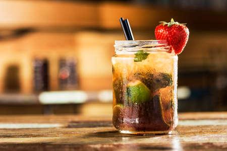 mohito: Fresh strawberry mohito on a pub. Stock Photo