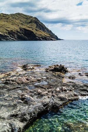 rocky coastline: Beautiful sunny seascape from rocky coastline Stock Photo