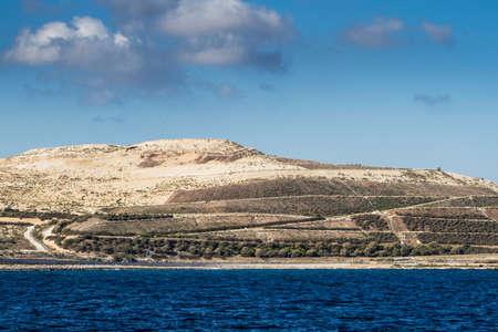 Maltese coast landscape on sunny day.