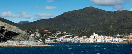 Panoramic landscape of Cadaques from the sea in a sunny day. Spain.