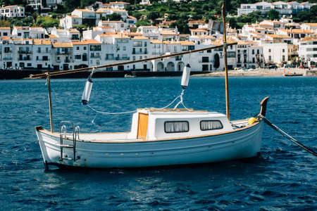 White boat in a Cadaques bay. Spain.