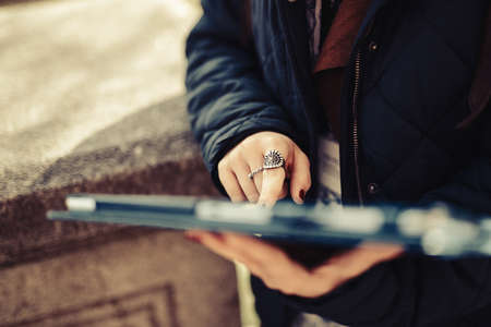 Woman hands using tablet outdoors in the street. Archivio Fotografico