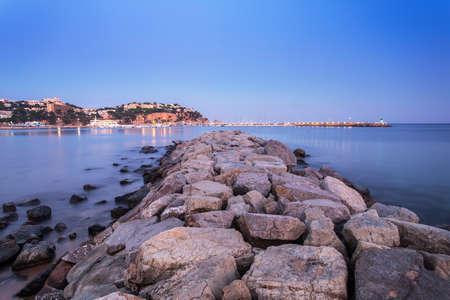 Night landscape of Sant Feliu de Guixols beach in Costa Brava, Spain.