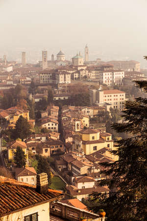 Aerial view of Bergamo in a foggy day, Italy.