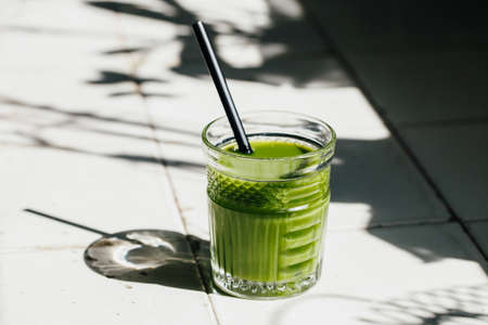 Green detox juice glass  with copy space.
