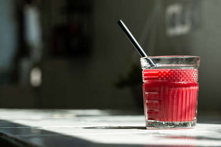 Red smoothie juice glass  with copy space.