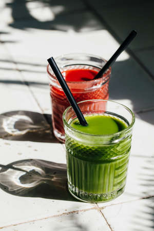 Red and green detox juice glass  with copy space.