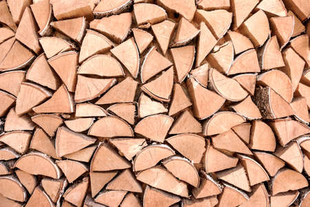 home heating: chopped firewood stacked in a woodpile for home heating