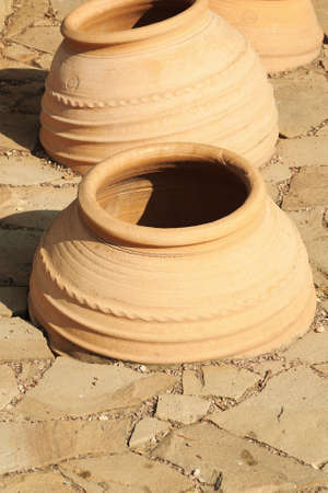 inebriation: Large ceramic pots dug into the ground for the production of wine in Taman, Krasnodar region of Russia Stock Photo