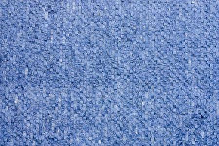 Fragment of decorative finishes wall small stone cubes closeup 版權商用圖片