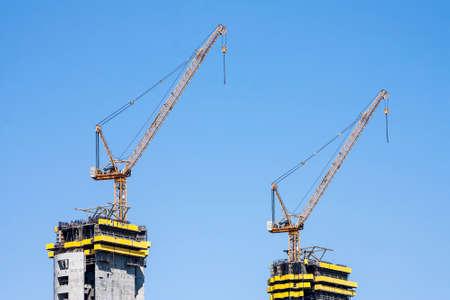 Cranes manufacturing construction work. Close-up panorama City, Stock Photo