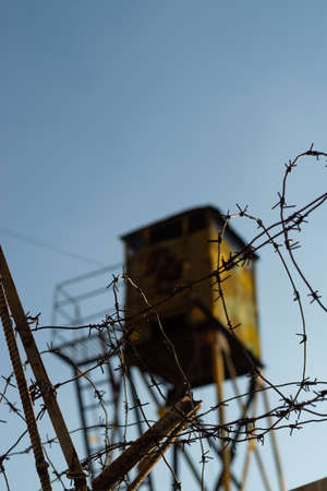 Barbed wire and watchtower of the military unit