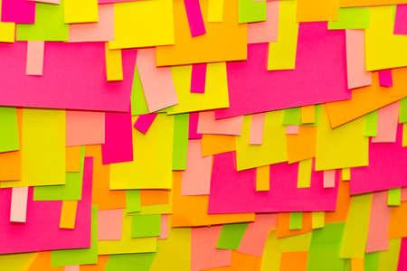 Bright multi-colored stickers on the office white board.