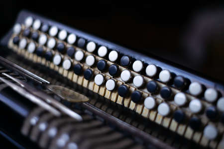 The old rare accordion buttons close up view. Low light photo. Stok Fotoğraf
