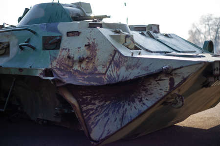 Damaged body of a military armored infantry. Outdoor military vehicles museum. Armor is damaged at the battlefield.