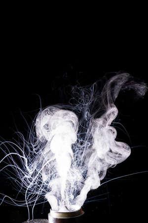 Splash glicerine on vape spiral. Big clouds of fog with visible tracers. Vape culture and no smoking.